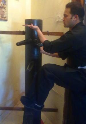 Sifu Shiv practicing on his personal Muk Yan Jong